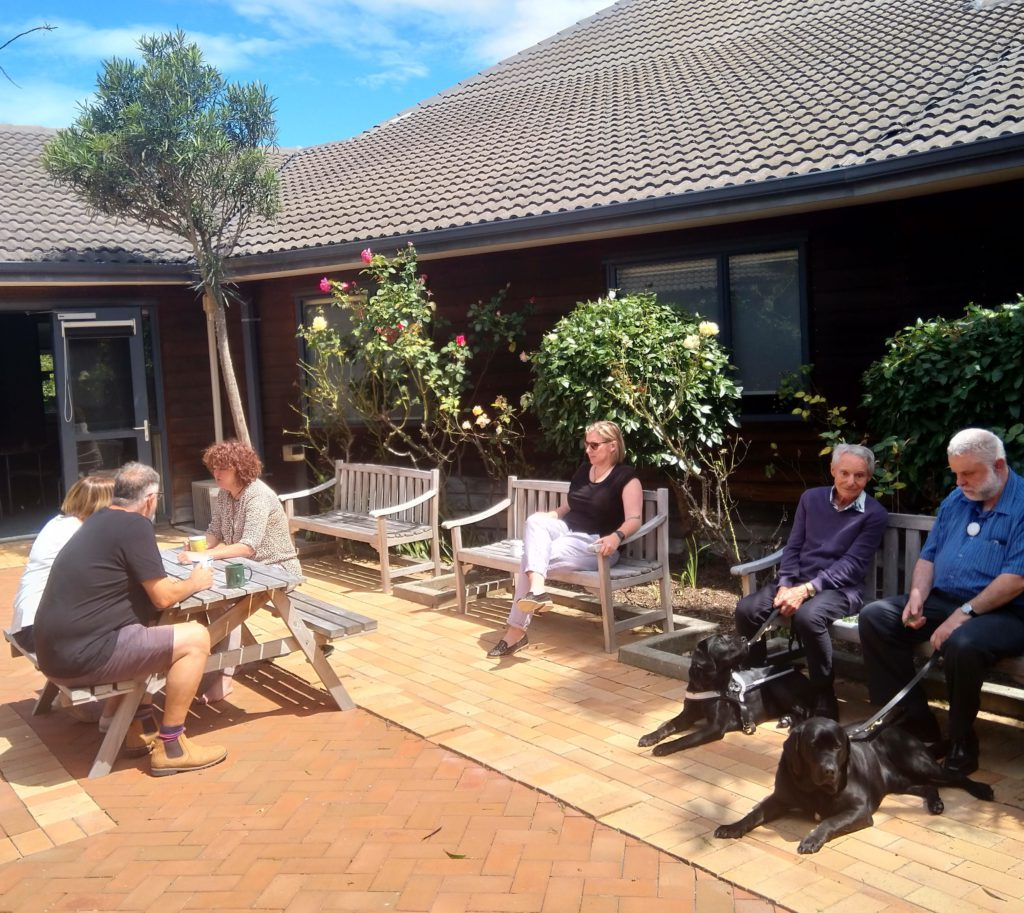 Board members enjoying the sunshine after meeting at the Blind Low Vision NZ offices in Christchurch
